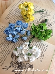 Mini paper roses.x 1 bunch
