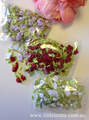 Petite rose with leaf decorations.  Bulk Buy! Bag of 100 roses.