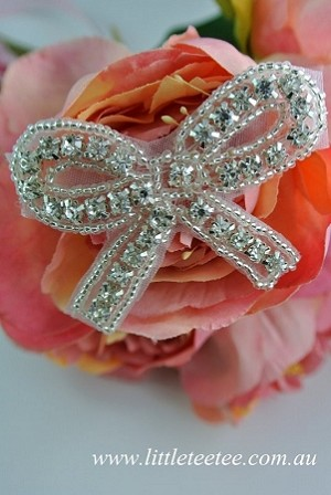 Diamonte applique. Dainty bows.